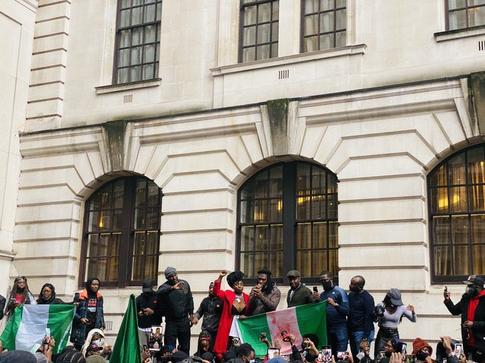 Burna Boy and Other Nigerians Protest At The Nigeria High Commission in London.