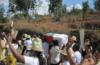 During Famadihana Festival, The Malagasy People Unearth The Bones Of Their Loved Ones From The Grave, Rewrap And Dance Around The Street With The Bones